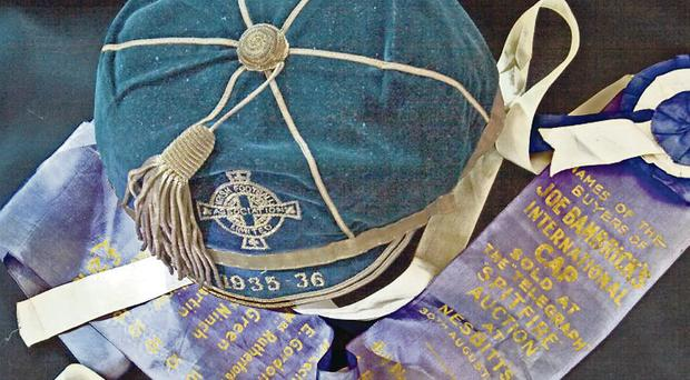 Glittering career: the cap of Joe Bambrick and the garland when it was sold for Spitfires