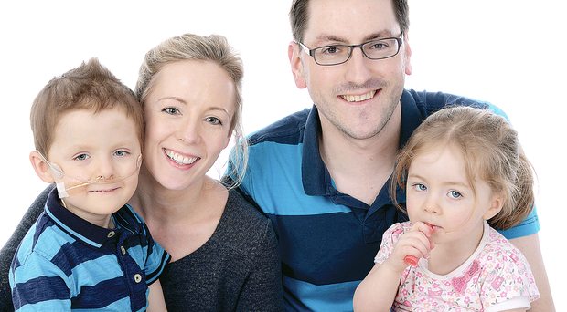 Fighting on: Leona and a treasured family picture with her husband Stephen, Oscar and daughter Izzie