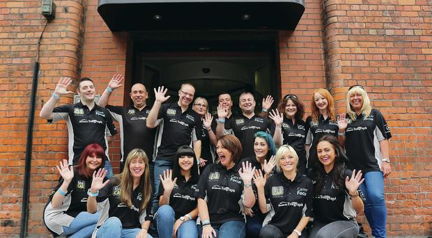 Belfast Telegraph staff outside the office yesterday before setting off on their challenge to climb Ben Nevis