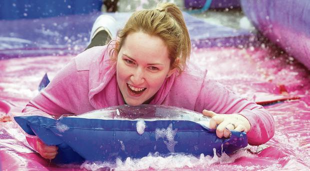 Salome Preston accelerates down the giant slide in Derry's Shipquay Street which was transformed into a huge waterpark