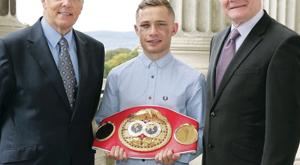 First Minister Peter Robinson and deputy First Minister Martin McGuinness with new IBF world champion Carl Frampton