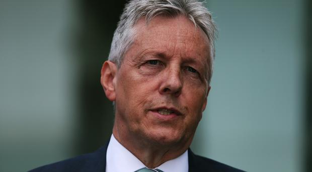 Peter Robinson said Stormont's mandatory coalition led by his Democratic Unionist Party and Sinn Fein could not continue in its current form
