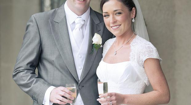 Gareth McKinstry and Anna Diamond toasting their big day