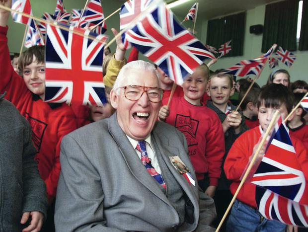 A laughing Ian Paisley with schoolchildren in 1999