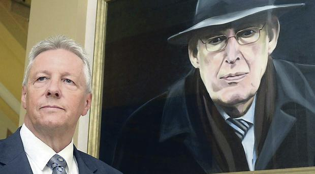 First Minister Peter Robinson pauses for a moment yesterday at a portrait of Ian Paisley that hangs at Stormont