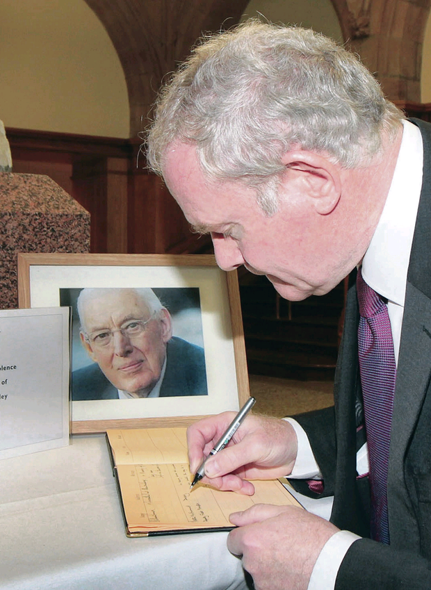Martin McGuinness signs the Book of Condolence at Derry's Guildhall