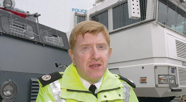 Former Assistant Chief Constable Duncan McCausland in his PSNI role. The police training paid dividends when he spotted a suspect being chased by officers in Belfast