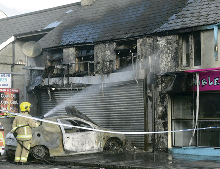 The car was set on fire and directed at the Chinese takeaway, which soon went up in flames