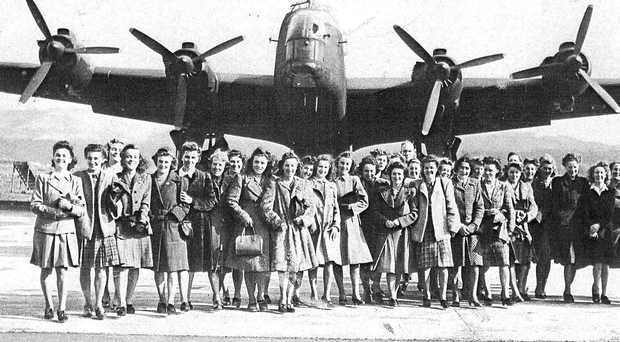 Girls from the Altona and Long Kesh bases in front of a Stirling bomber on a visit to the main Shorts factory in 1944