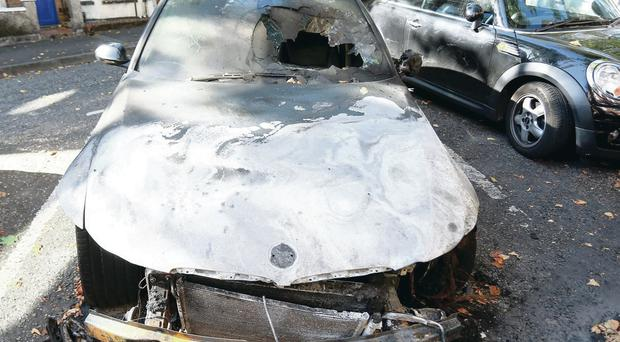 The charred remains of some of the vehicles set ablaze in a small area of south Belfast over the weekend. Police do not believe the attacks were racist in nature