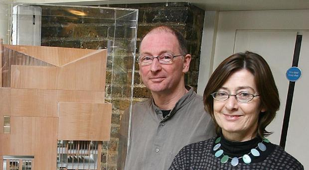 Architects John Tuomey and Sheila O'Donnell with a model of the Photographers' Gallery, built in Soho, London