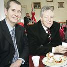 Edwin Poots and Peter Robinson sharing a cup of tea and scones in 2010