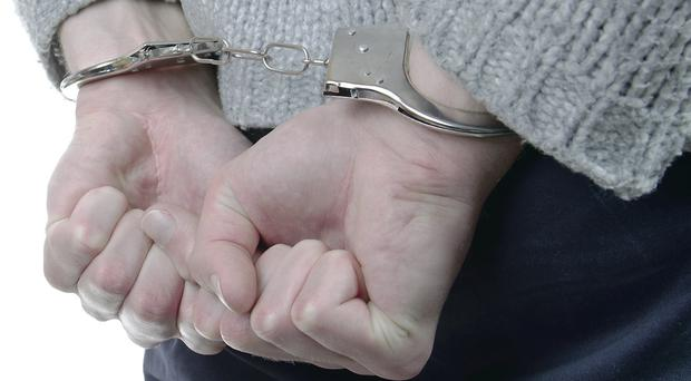 A judge has reacted with fury after a 13-year-old boy was brought into court in handcuffs. Picture posed