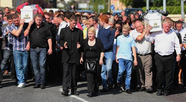 Parents Thomas and Helen O'Driscoll (centre) walk in front of the cortege at the funeral of twin boys Thomas and Patrick O'Driscoll