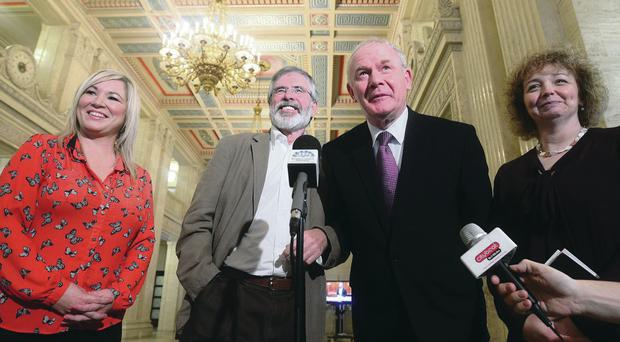 Gerry Adams TD and Martin McGuinness MLA speak to the media at Stormont yesterday