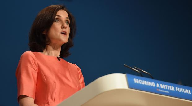 Northern Ireland Secretary Theresa Villiers addresses the Conservative Party conference in Birmingham