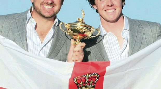 Graeme McDowell and Rory McIlroy pose with the Northern Ireland flag and the Ryder Cup in 2010