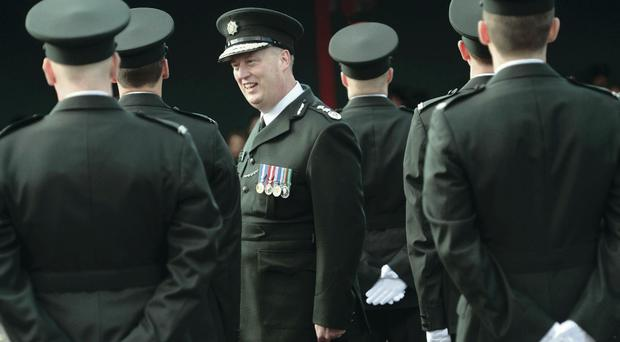 Chief Constable George Hamilton inspects his 38 recruits at their passing out parade