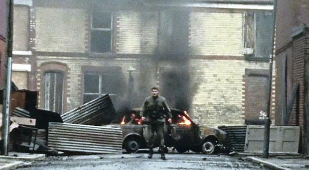 Jack O'Connell during a street riot in Belfast
