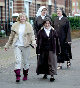 Martina Purdy on her way to Mass yesterday at St Peter's Cathedral, Belfast, with Elaine Kelly, new Postulate, Novice Maura and Sister Kathleen from Adoration Convent on the Falls Road