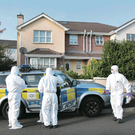 Forensics at the house in Ballyarnett village, Londonderry, where a viable bomb was found