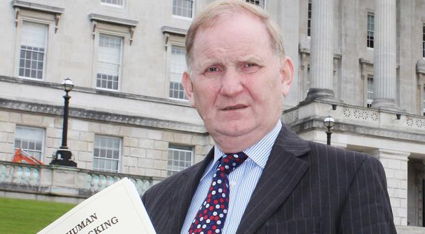 Lord Morrow holds the Human Trafficking and Prostitution Bill outside Stormont