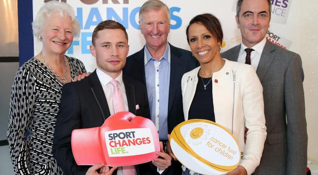Olympic gold medalists Dame Mary Peters and Dame Kelly Holmes with Leslie Hughes (centre) from Hughes Insurance, boxer Carl Frampton and actor James Nesbitt at the Culloden Hotel yesterday. The event was organised by Leslie Hughes to raise money for two local charities