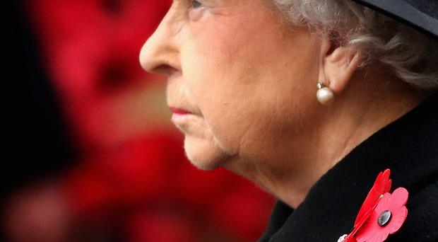The Queen at the Cenotaph in London yesterday