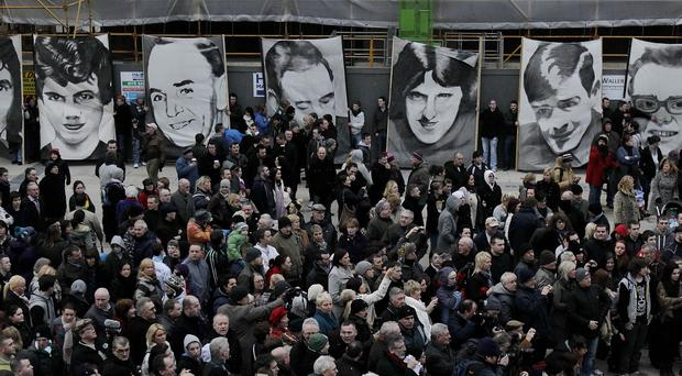 Pictures of the victims of Bloody Sunday held aloft during a march in the Bogside area of Londonderry