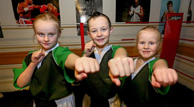 Kick boxers Racehel McGuigan (10) Damien McGuigan (10) and Rebecca McGuigan (7)