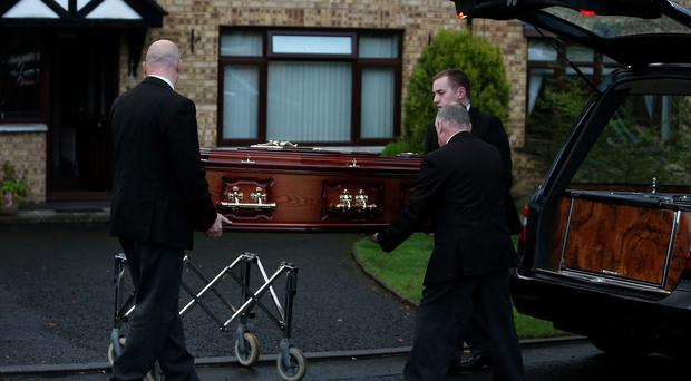 The remains of 'disappeared' victim Brendan Megraw are brought to his brother's home in Belfast