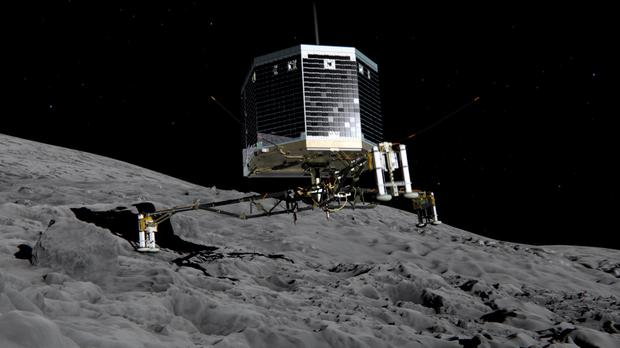 Photo illustration provided by the European Space Agency (ESA) shows the Philae lander descending onto the 67P/Churyumov-Gerasimenko comet