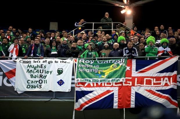 Northern Ireland fans look dejected after the final whistle during the UEFA Euro 2016 qualifier at the Arena Nationala, Bucharest