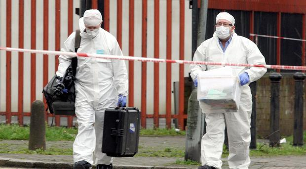 Staff from the Police Service of Northern Ireland are examining the scene in North Belfast