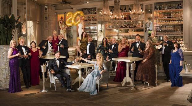 Some of the millionaires the National Lottery has created have raised a glass of bubbly to toast the anniversary (Camelot PR)