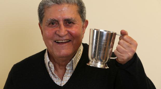 Arzhic Basirov with the Queen's University tankard from 1962