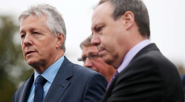 First Minister Peter Robinson and Nigel Dodds outside Stormont Castle yesterday