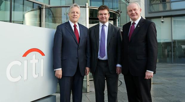 First Minister Peter Robinson and Deputy First Minister Martin McGuinness with James Bardrick at the Citi offices in Belfast (Press Eye/PA)