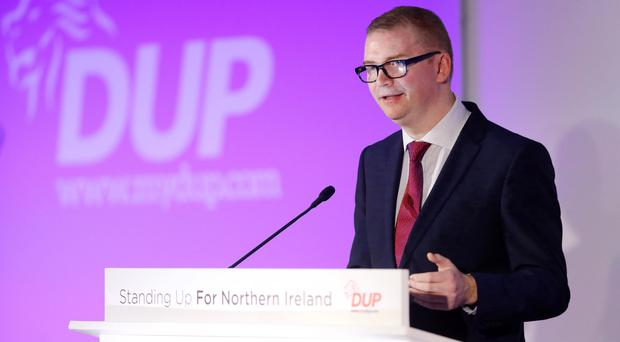 Finance Minister Simon Hamilton speaks at the first day of the DUP party conference at La Mon Hotel near Belfast yesterday