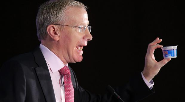 Gregory Campbell holds a yoghurt during his speech at the DUP conference on Saturday
