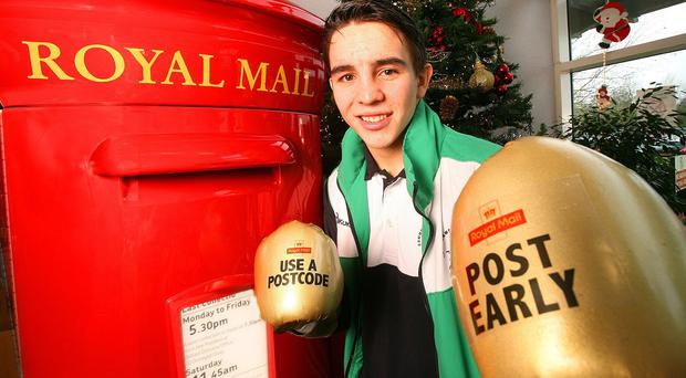 Commonwealth Games gold medallist Michael Conlan urges Royal Mail customers to 'box clever' by posting early this Christmas (Royal Mail/PA)