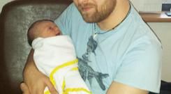 Pride: Dad Robbie with little Theo, who weighed 8lbs