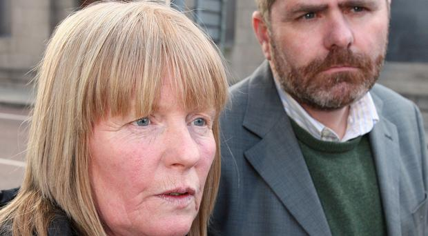 Teresa Slane, widow of murdered west Belfast man Gerard Slane, outside the coroner's court after a preliminary hearing