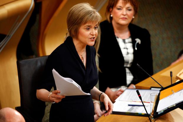 First Minister Nicola Sturgeon answers questions from opposition leaders during Question Time in the Scottish Parliament yesterday