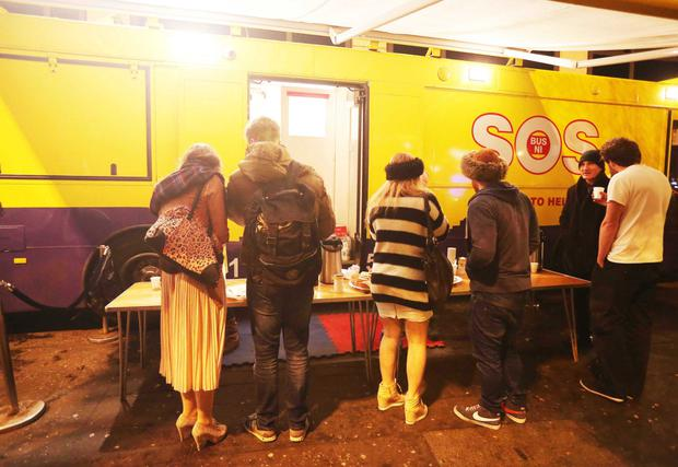 Young people visiting the SOS bus in Shaftesbury Square