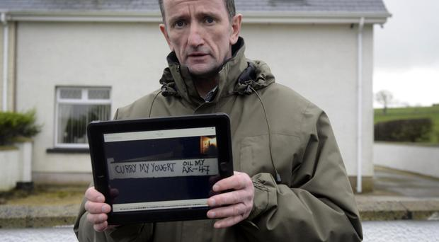 George Duddy outside his home after it was attacked by vandals