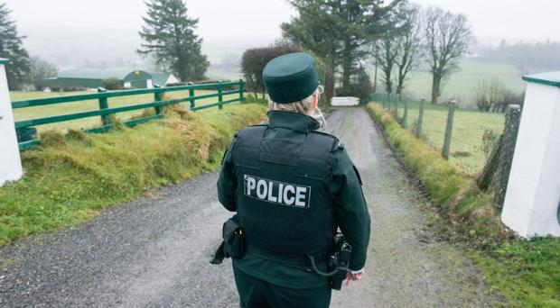 A police officer near the isolated cottage at Aughabrack near Dunamanagh, where a 77-year-old retired farmer was tortured by a gang