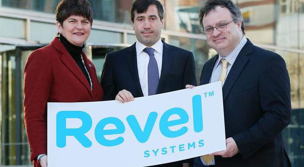 Trade and Investment Minister Arlene Foster and Employment and Learning Minister Dr Stephen Farry, right, with co-founder of Revel Systems Chris Ciabarra in Belfast (Kelvin Boyes/Press Eye/PA)