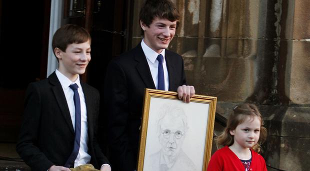 Jack Kyle's grandchildren (from left) Calum, Jack, and Erin, with a picture of WB Yeats, an Irish cap and rugby jersey and a stethoscope belonging to their grandfather