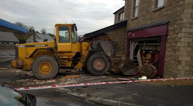 A digger which was used to ram a shop in Aughnacloy, Co Tyrone, in an attempt to steal a cash machine (PSNI/PA)